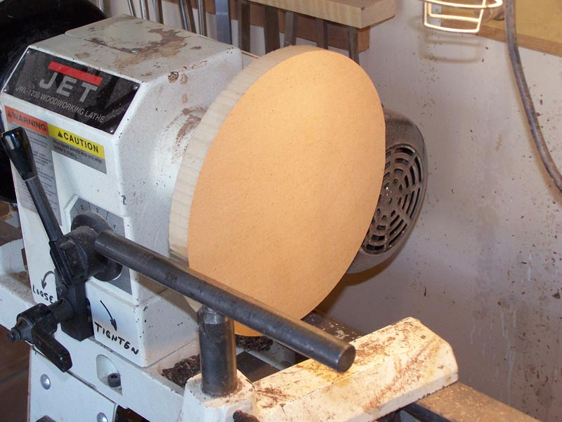 Mount on the lathe and true the outside