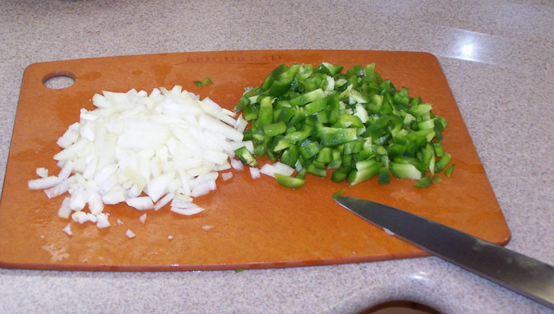 Cut up the onion and green pepper